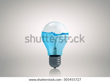 Energy and ecology concept with light bulb with water inside