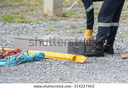 Carpenter Uses Nail Gun Attach Asphalt Stock Photo