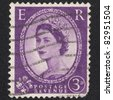 ENGLAND-CIRCA 1952:A stamp printed in ENGLAND shows image of Elizabeth II (Elizabeth Alexandra Mary, born 21 April 1926) is the constitutional monarch of United Kingdom in red, circa 1952. - stock photo