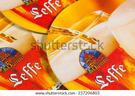 ENGLAND,LONDON - November 11, 2014: Beermats from Leffe Beer.Leffe, a brewing tradition since 1240. Founded in 1152, Notre-Dame de Leffe was an abbey of Premonstratensian canons.