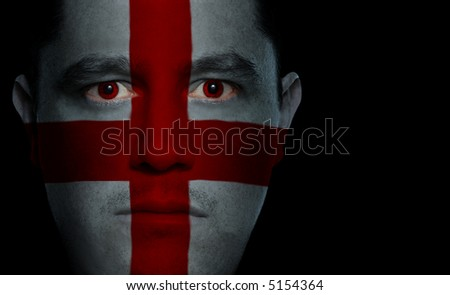 English flag painted/projected onto a man's face.