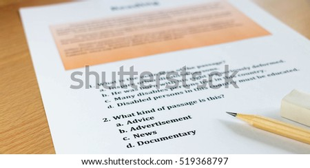 english reading test sheet on table