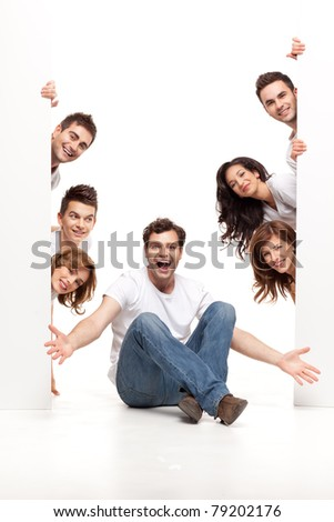enthusiastic young man sitting with happy friends