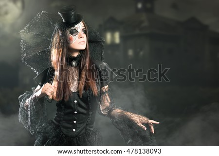 Entrance is limited to nightclub, dress code. Fashion young woman going to Halloween party 2016! Beautiful woman like doll with umbrella and hat. Moon, scary cemetery. Hallowen costumes
