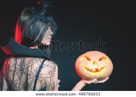 Entrance is limited to nightclub, dress code. Fashion young woman with pumpkin going to Halloween party 2016! Beautiful woman like witch. Moon, scary cemetery. Hallowen costumes, pumpcin