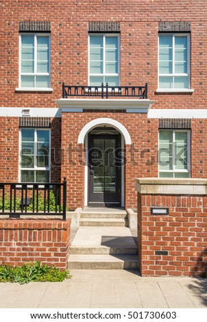 Entrance of new apartment building with concrete steps and brick fence in  frontExterior Old Red Brick Home Double Stock Photo 58184419   Shutterstock. Brick Apartment Building Entrance. Home Design Ideas