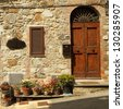 entrance  to the tuscan villa with many flowerpots on the street, Italy - stock photo