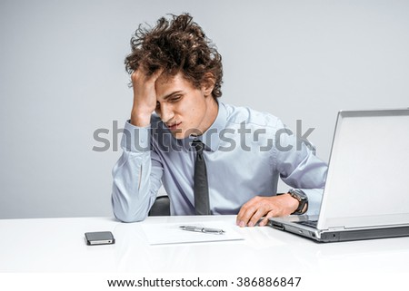 Entrepreneur dissatisfied with his work. Modern businessman at the workplace, depression and crisis concept