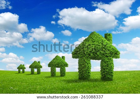 Environment ecology nature home integration concept. Green houses walking on a summer meadow under the blue sky