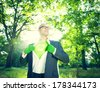 Environmentalist Superhero Businessman in Nature - stock photo