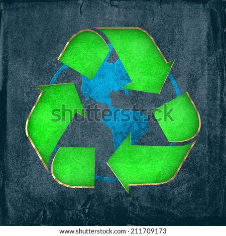Environmentally friendly - Recycle sign cut-out on cardboard with a print of the globe