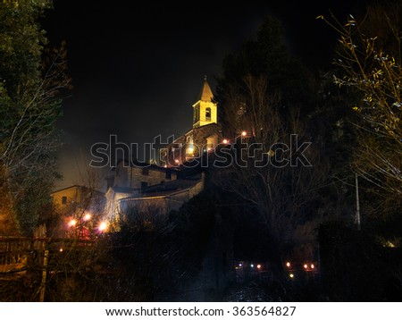 Equi Terme village in Lunigiana, view of the church. Photo taken during Epiphany celebrations hence lights. Beautiful north Tuscan village by night.