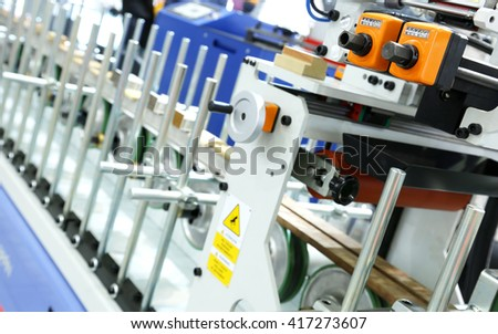 Equipment for production of furniture facades