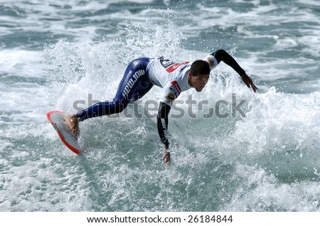 ERICEIRA, PORTUGAL - AUGUST 26, 2008 : Brazilian surfer surfing a wave at the Buondi Billabong Pro surfing event that was held in Ericeira, Portugal in August 26, 2008.