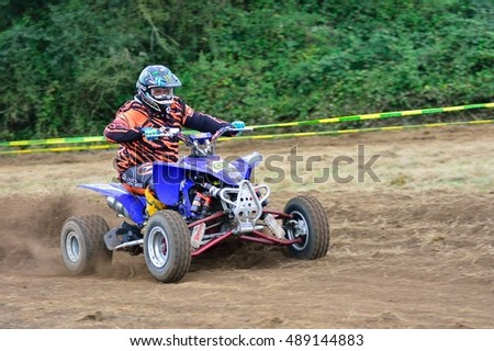"ESCAMPLERO, SPAIN - SEPTEMBER 25: Unidentified racer rides a quad motorbike in the ""Promotion Quad Trophy Astur"" on September 25, 2016 in Escamplero, Spain."