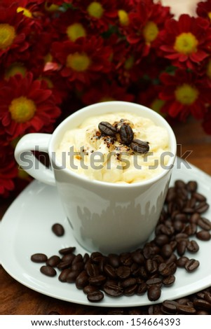 Espresso con panna coffee and Red chrysanthemum flower