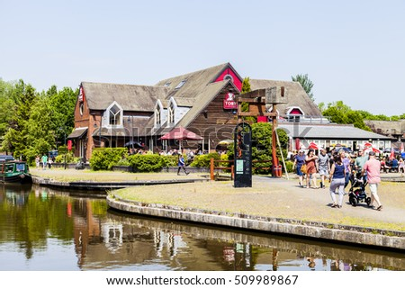 Etruria, Stoke On Trent, England. U.K - June 5 2016 : People enjoying a day at the Toby Inn Carvery Restaurant next to the Trent and Mersey Canal.