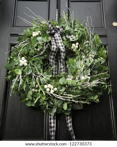 Eucalyptus Christmas wreath hung on a black door