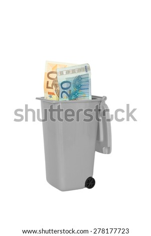 Euro banknotes in a green rubbish or garbage bin, isolated, copy space