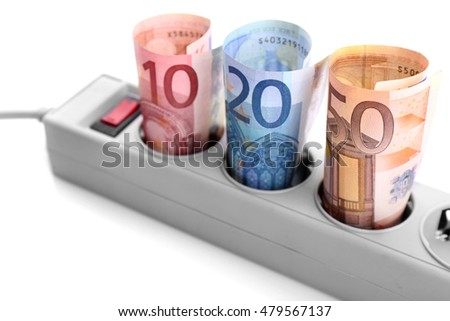 Euro banknotes in power socket on white background