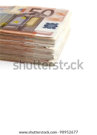 Euro banknotes stacked on white background