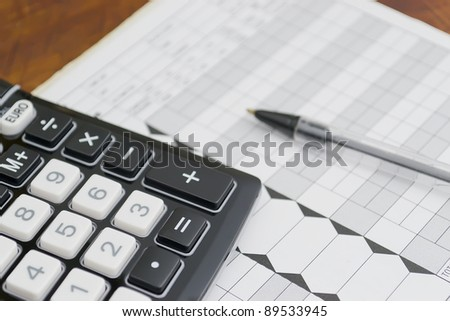 euro converter-calculator, on a paper with a pen