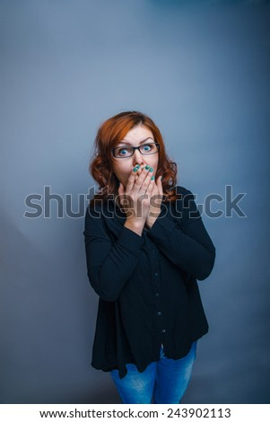 European - looking  woman 30 years  his  hands  over his mouth