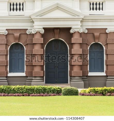 Arch molding decorates on plain concrete stock photo for European style windows