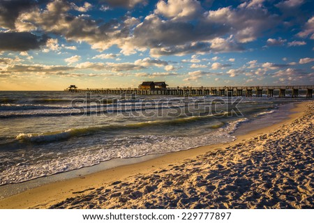 Evening clouds over the fishing pier and Gulf of Mexico in Naples, Florida.
