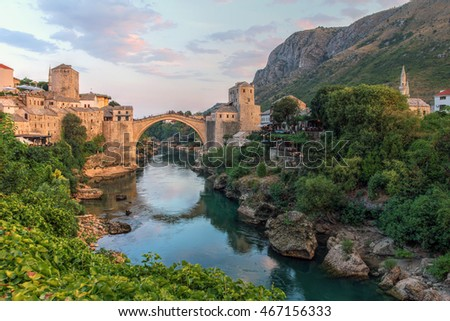 Evening scene in Mostar with the medieval town and the historic bridge over the Neretva river in Bosnia Herzegovina.