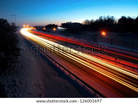 Evening traffic on highway with streaks of light
