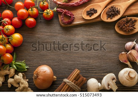 everything on wood table for the preparation of acute Italian sauce (tomato garlic spices olive oil)