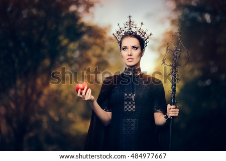 Evil Queen with Poisoned  Apple in Fantasy Portrait - Beautiful dark princess using black magic spell