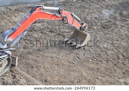 Excavator mechanical shovel digger digging a hole in the ground
