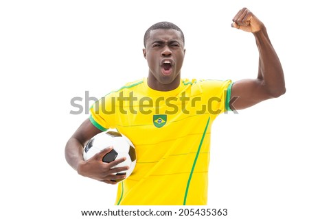 Excited brazilian football fan cheering holding ball on white background
