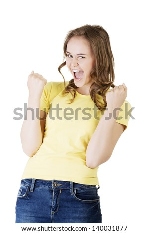 Excited happy success young woman with fists up, isolated on white