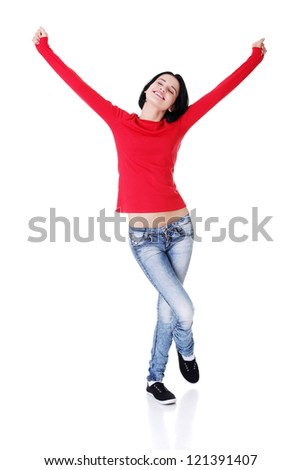 Excited happy young woman with fists up, isolated