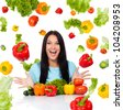 excited woman happy smile natural raw vegetable fly around red tomato pepper greens, girl sitting at the table isolated over white background, concept of healthy organic food vitamin diet - stock photo