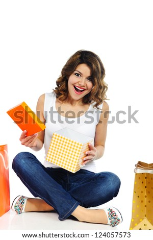Excited young girl opening present box isolated on white background