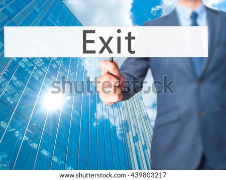 Exit - Businessman hand holding sign. Business, technology, internet concept. Stock Photo