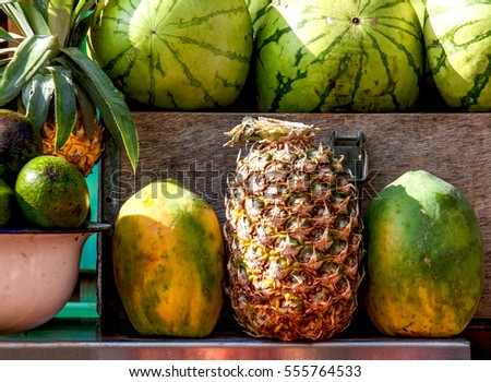 Exotic fruits: pineapple, papaya, watermelon with avocado on market table. Israel. Useful for background.
