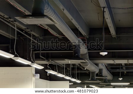 Exposed ceiling duct work in a modern high efficiency commercial HVAC system in a renovated school.