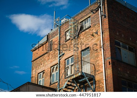 External fire escape stair on an old bricked building.