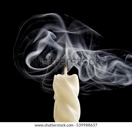 Extinguished candle with smoke.Isolated over black