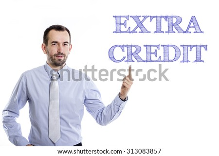 EXTRA CREDIT - Young businessman with small beard pointing up in blue shirt