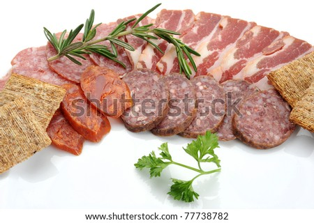 Extreme close-up image of salami with served with crackers