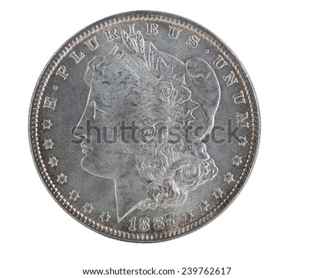 Extreme close up of an American Morgan Silver Dollar, with full rim edge and natural toning, isolated on white