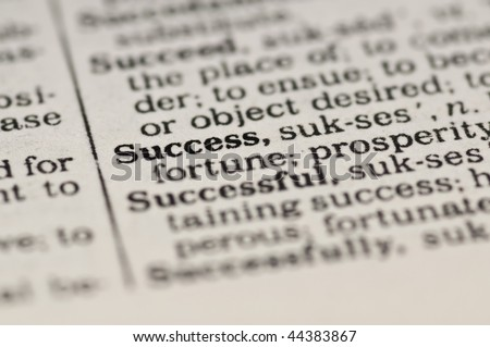 Extreme close up of the word SUCCESS found inside a dictionary