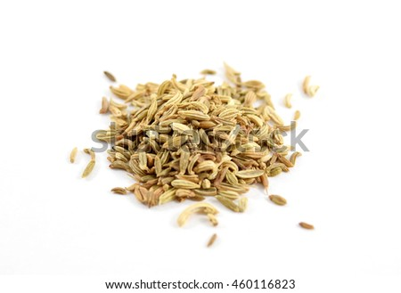 Extreme closeup (macro) of organic fennel seeds - isolated