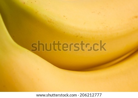 Extreme detail of bananas with slight bruising.